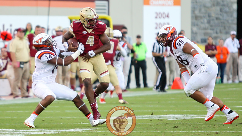 LB Tavante Beckett (14) tries to strip the ball out of Boston College QB Darius Wade's hands late in the game. (Mark Umansky/TheKeyPlay.com)