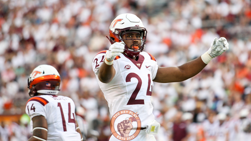 LB Anthony Shegogg pumps up the crowd late in the game with the Hokies up big. (Mark Umansky/TheKeyPlay.com)