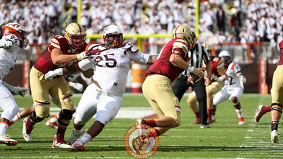DT Tim Settle (25) is held as he tries to rush Boston College QB Patrick Towles. (Mark Umansky/TheKeyPlay.com)