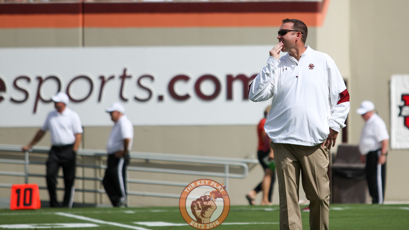 Former Hokies and current Boston College offensive coordinator Scot Loeffler watches his team warmup before the game. (Mark Umansky/TheKeyPlay.com)