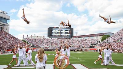Virginia Tech cheerleaders perform a synchronized flip during a media timeout. (Mark Umansky/TheKeyPlay.com)