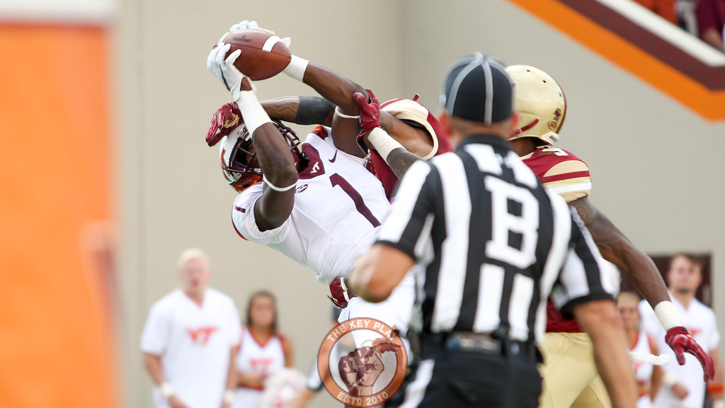 WR Isaiah Ford (1) catches a touchdown pass while double covered in the second quarter. (Mark Umansky/TheKeyPlay.com)