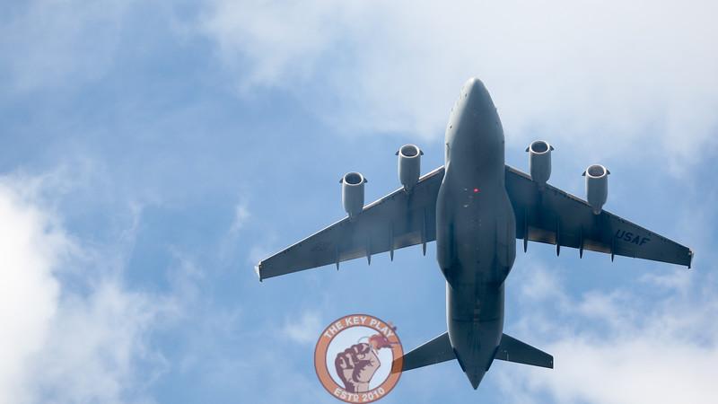 A C-17 cargo plane flies over Lane Stadium as the national anthem comes to a close. (Mark Umansky/TheKeyPlay.com)