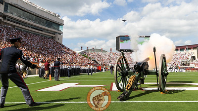 Skipper, the Corps of Cadets cannon, is fired during the national anthem as a C-17 cargo plane flies over Lane Stadium for Military Appreciation Day. (Mark Umansky/TheKeyPlay.com)