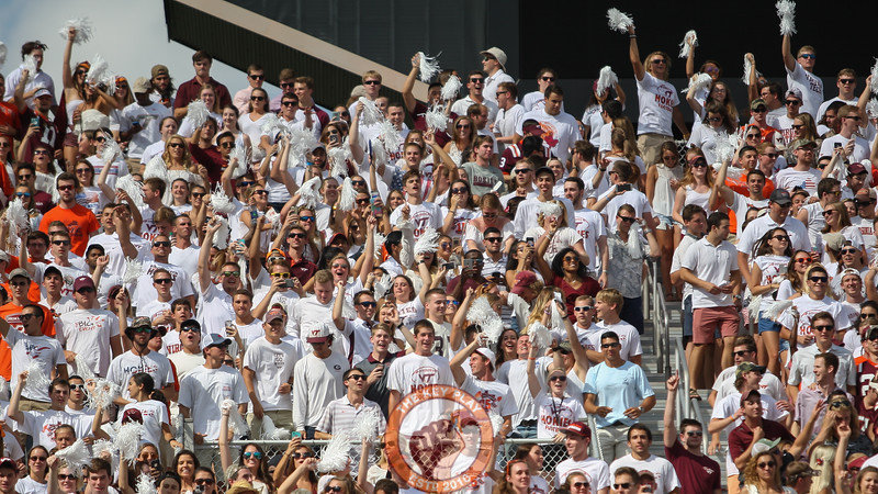 Students jump up and down to Enter Sandman before the Hokies enter the field. (Mark Umansky/TheKeyPlay.com)