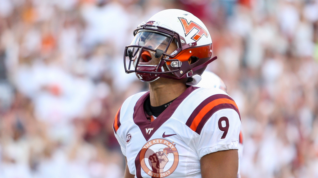 QB Brenden Motley celebrates a rushing touchdown in the 4th quarter to put the Hokies up 49-0. (Mark Umansky/TheKeyPlay.com)