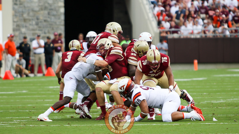 Brandon Facyson (31) hits Boston College QB Patrick Towles hard on a busted play. (Mark Umansky/TheKeyPlay.com)