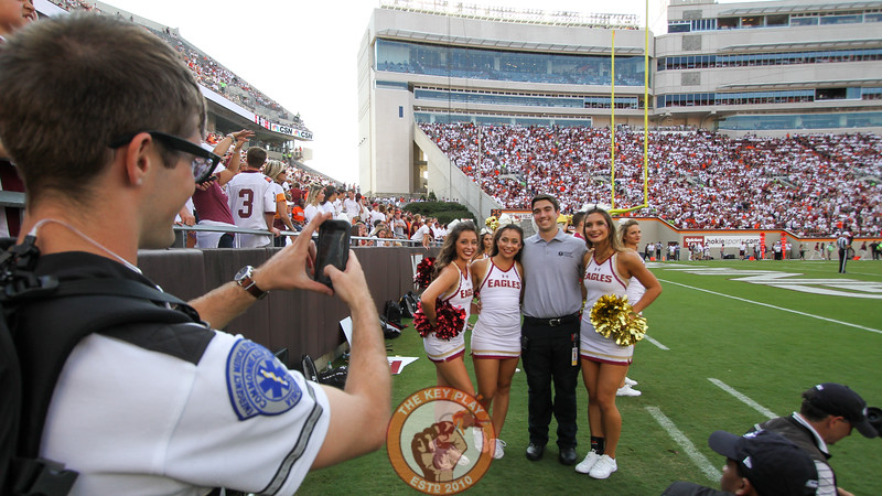 Members of the Boston College cheer squad pose with a member of the Blacksburg Volunteer Rescue Squad in the third quarter. (Mark Umansky/TheKeyPlay.com)