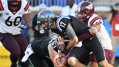 Virginia Tech defensive tackle Ricky Walker (98) wraps up Duke quarterback Daniel Jones (17). (Michael Shroyer/TheKeyPlay.com)