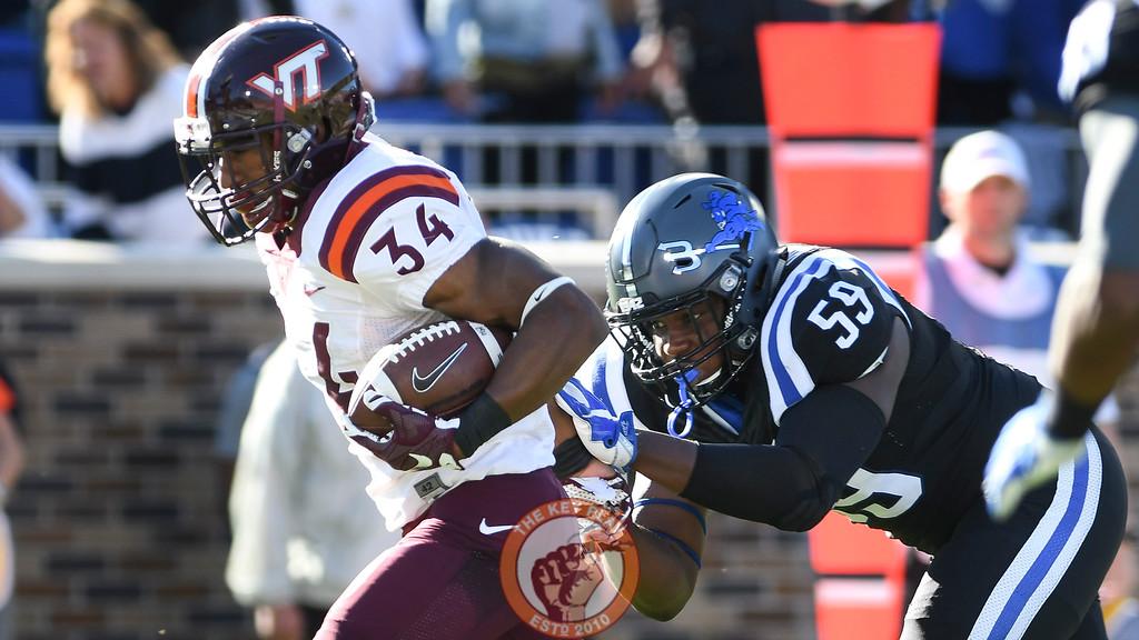 Virginia Tech running back Travon McMillian (34) runs past Duke defensive end James Hornbuckle (59) to score the opening touchdown. (Michael Shroyer/TheKeyPlay.com)