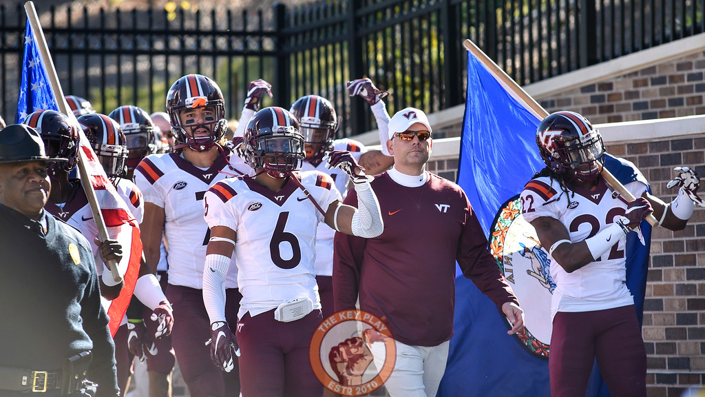 Virginia Tech safety Mook Reynolds (6), head coach Justin Fuente, and rover Terrell Edmunds (22) lead the team from the locker room. (Michael Shroyer/ TheKeyPlay.com)