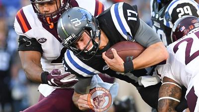 Virginia Tech defensive back Chuck Clark (25) hits Duke quarterback Daniel Jones (17). (Michael Shroyer/TheKeyPlay.com)
