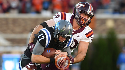 Virginia Tech defensive lineman Vinny Mihota (99) wraps up Duke quarterback Daniel Jones (17). (Michael Shroyer/TheKeyPlay.com)