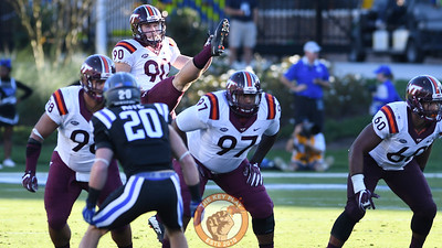 Virginia Tech punter Mitchell Ludwig (90) kicks without pressure from Duke. (Michael Shroyer/TheKeyPlay.com)