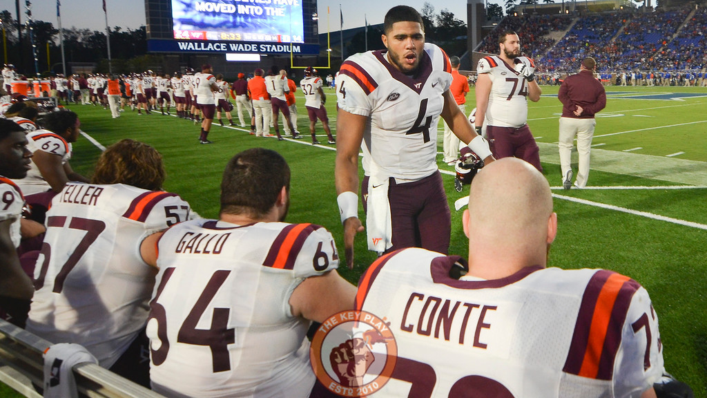 Virginia Tech quarterback Jerod Evans (4) high fives and motivates his offensive lineman on the sideline. (Michael Shroyer/TheKeyPlay.com)