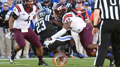 Virginia Tech linebacker Tremaine Edmunds (49) lays a big hit on Duke running back Joseph Ajeigbe (23). (Michael Shroyer/TheKeyPlay.com)