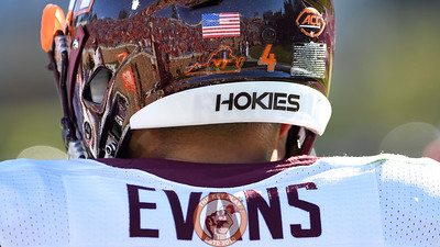 A strong Virginia Tech crowd is seen reflected in the helmet of quarterback Jerod Evans. (Michael Shroyer/TheKeyPlay.com)