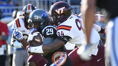 Virginia Tech defensive end Trevon Hill (94) hits Duke running back Shaun Wilson. (Michael Shroyer/TheKeyPlay.com)