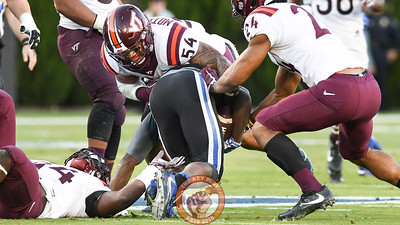 Virginia Tech linebackers Andrew Motuapuaka (54) and Anthony Shegog (24) bring down the Duke runner. (Michael Shroyer/TheKeyPlay.com)