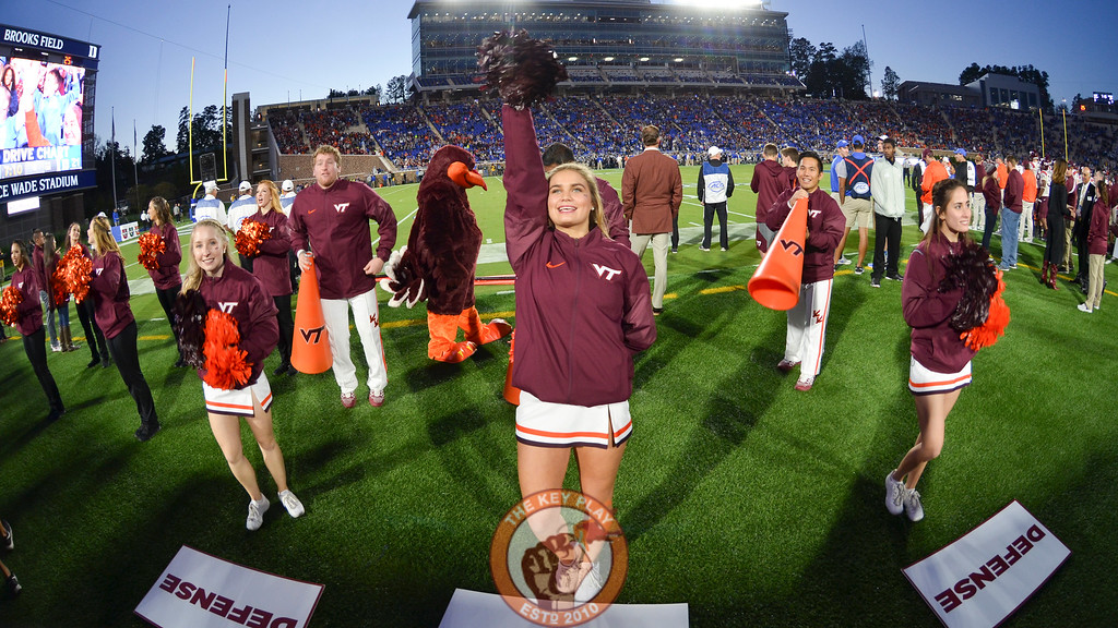 Members of the Virginia Tech Hokies cheerleading squad perform on the sideline. (Michael Shroyer/TheKeyPlay.com)