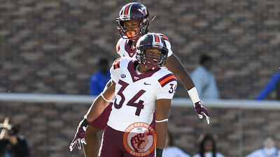 Virginia Tech running back Travon McMillian (34) celebrates his touchdown run with wide receiver Cam Phillips (5). (Michael Shroyer/TheKeyPlay.com)