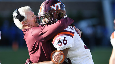 Virginia Tech cornerback Adonis Alexander (36) celebrates his touchdown with special teams coach James Shibest. (Michael Shroyer/TheKeyPlay.com)