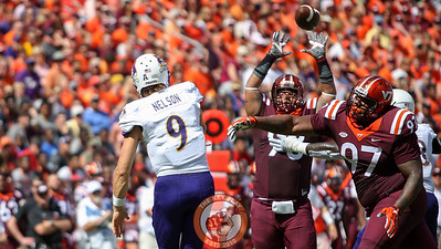 DT Tim Settle (97) and  DT Ricky Walker (98) almost block an ECU pass in the first quarter. (Mark Umansky/TheKeyPlay.com)