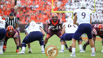 LB Andrew Motuapuaka (54) stares down the ECU quarterback before the snap.  (Mark Umansky/TheKeyPlay.com)