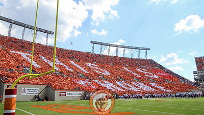 """The East stands in Lane Stadium participate in a card stunt at the end of the first quarter as a part of Hokiesports' """"This Is Home"""" marketing campagain. (Mark Umansky/TheKeyPlay.com)"""
