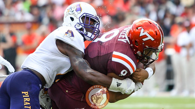 QB Brenden Motley (9) holds onto the ball tightly as ECU's DaShawn Benton tackles him close to the goal line.  (Mark Umansky/TheKeyPlay.com)