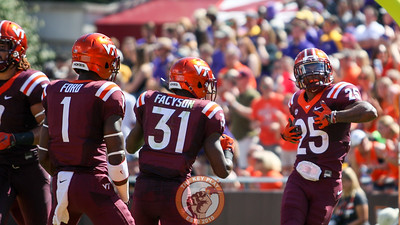 Greg Stroman (25) celebrates while wearing former head coach Frank Beamer's jersey number after scoring a punt return touchdown. (Mark Umansky/TheKeyPlay.com)