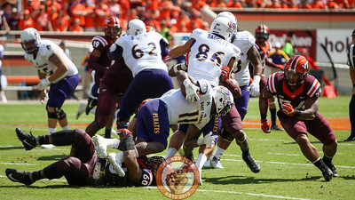 DE Woody Baron (60) and LB Andrew Motuapuaka (54) combine on a tackle on ECU's James Summers.  (Mark Umansky/TheKeyPlay.com)