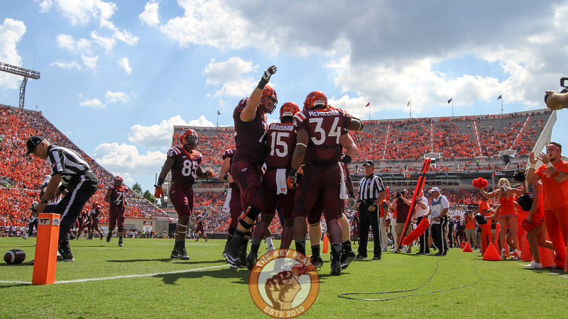 The Hokies celebrate in the endzone after going up by four touchdowns.  (Mark Umansky/TheKeyPlay.com)