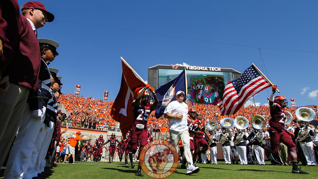 Head coach Justin Fuente (white) leads his team out onto the field during Enter Sandman. (Mark Umansky/TheKeyPlay.com)