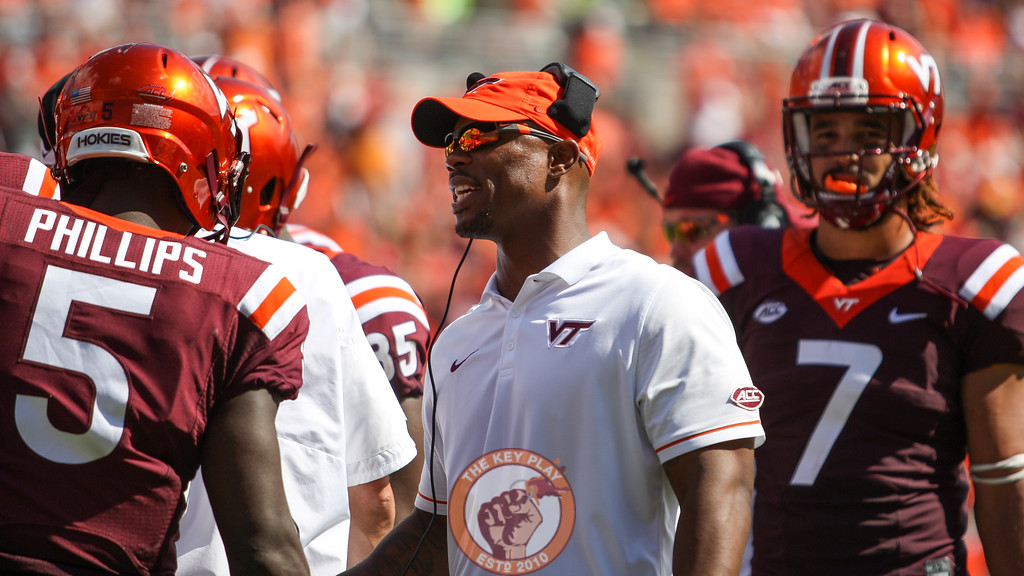 Wide recievers coach Holmon Wiggins speaks with WR Cam Phillips before the Hokies take the field.  (Mark Umansky/TheKeyPlay.com)