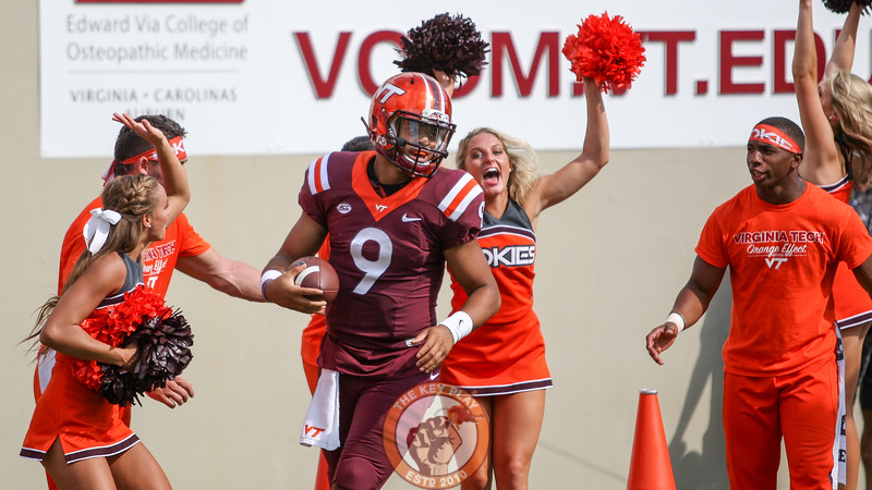 QB Brenden Motley celebrates on the sidelines after his touchdown run puts the Hokies up 54-14 in the fourth quarter. (Mark Umansky/TheKeyPlay.com)