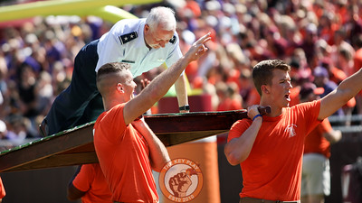 Corps of Cadets Commandant Maj. General Randal Fulhart (Ret.) does pushups in front of the Cadet's section after the Hokies' first score of the day. (Mark Umansky/TheKeyPlay.com)