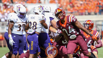 LB Anthony Shegog (24) smiles after the Hokies stop ECU for a loss. (Mark Umansky/TheKeyPlay.com)