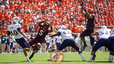 WR Cam Phillips (5) and TE Bucky Hodges (7) block an ECU punt in the second quarter. (Mark Umansky/TheKeyPlay.com)