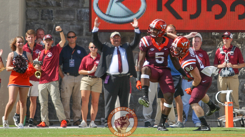 WR Cam Phillips (5) celebrates on the sidelines as the Hokies go up 38-0 in the first half.  (Mark Umansky/TheKeyPlay.com)