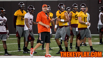Head coach Justin Fuente is surrounded by his quarterbacks during fall practice. (Mark Umansky/TheKeyPlay.com)