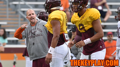 Offensive Coordinator/ Quarterbacks coach Brad Cornelsen gives instructions to quarterback Jerod Evans. (Michael Shroyer/ TheKeyPlay.com)
