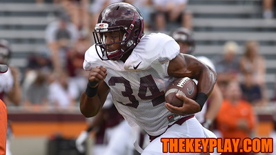 Running back Travon McMillian (34) carries the ball during practice. (Michael Shroyer/ TheKeyPlay.com)