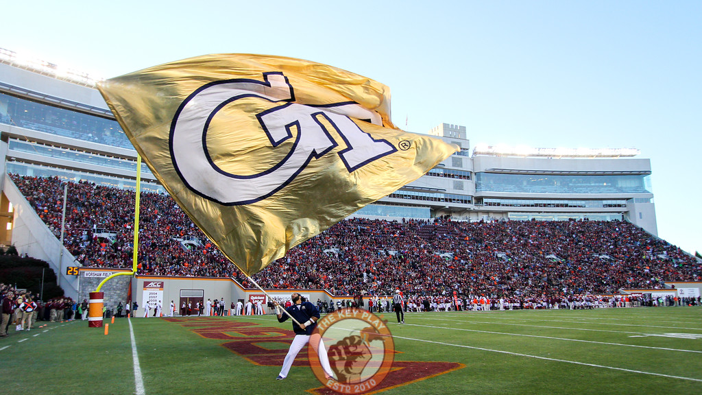 A Georgia Tech cheerleader waves a flag after a touchdown at the end of the first half. (Mark Umansky/TheKeyPlay.com)