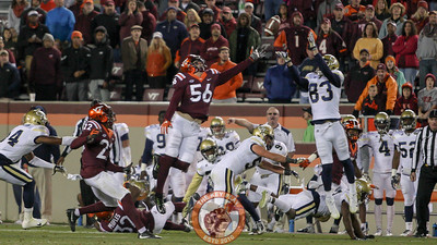 Georgia Tech WR Brad Stewart (83) reaches up to grab a Virginia Tech onside kick in the 4th quarter as they attempt a late comeback. (Mark Umansky/TheKeyPlay.com)