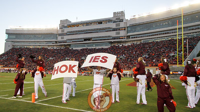 Virginia Tech cheerleaders lead a chant in Lane Stadium before the start of the second half. (Mark Umansky/TheKeyPlay.com)