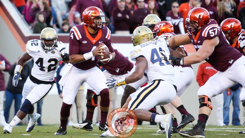 Virginia Tech QB Jerod Evans (4) looks to pass as the Georgia Tech pass rush gets close. (Mark Umansky/TheKeyPlay.com)