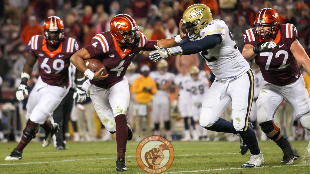 Virginia Tech QB Jerod Evans (4) tries to hold off Georgia Tech's Francis Kallon on a two point conversion attempt at the end of the game. (Mark Umansky/TheKeyPlay.com)