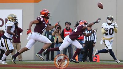 Georgia Tech DB Lawrence Austin (20) intercepts an overthrown pass as Virginia Tech RB Travon McMillian (34) tries to catch him. (Mark Umansky/TheKeyPlay.com)