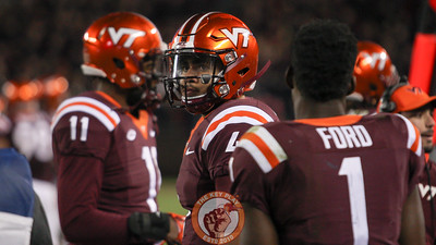 Virginia Tech QB Jerod Evans (4) looks up at the scoreboard late in the 4th quarter with the Hokies down big. (Mark Umansky/TheKeyPlay.com)